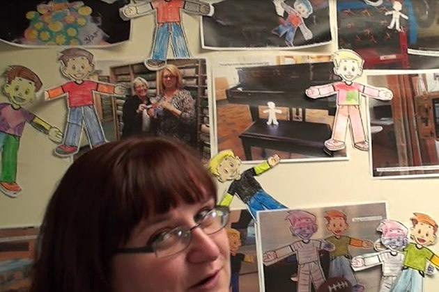 Amber gives tour of the 92 Moose Pittston School Flat Stanley Wall